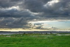 Meadow sea and clouds Stock Photo