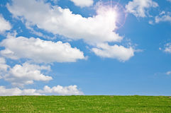 Meadow with Sky. This image shows a meadow with clouds and sun royalty free stock photography