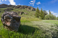 Meadow stone mountains Stock Photos