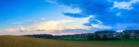Meadow and sunset sky Stock Photography