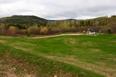 Meadow with tiny church Stock Photos