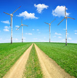 Meadow trail with wind turbines Stock Image