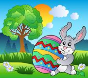 Meadow with tree and Easter bunny Stock Photo