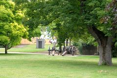 Meadow with trees and cannons in the city of Bonn in Germany Royalty Free Stock Image