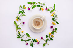 Meadow and wild flowers arranged in circle with coffe cup. Flat lay. Royalty Free Stock Photos