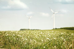 Meadow and wind turbines Royalty Free Stock Images
