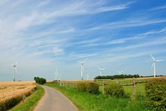 Meadow with wind turbines generating electricity Stock Photography
