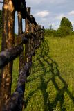 Meadow and wooden fence Royalty Free Stock Image