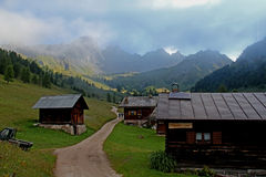 Meadows and alpine huts in Valfredda Stock Images