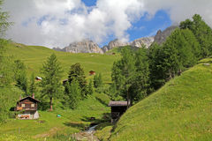 Meadows and alpine huts in Valfredda Stock Image
