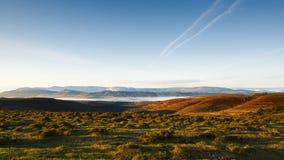 Meadows and blue sky at dawn, Sierra Salvada. Spain Stock Photo