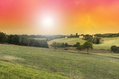 Meadows in the French Limousin. Early in the morning. Landscape in France at sunrise, hills, fields, sky and sunlight Royalty Free Stock Photo