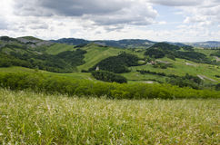 Meadows, green hills and clouds. Castellarano green hills - Appennini Modenesi -  Region of Emilia-Romagna - Northern Italy - Europe - Travel - Eco Tourism Stock Photo