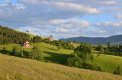Meadows, Hills and Village Houses Royalty Free Stock Photo