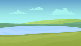 Meadows and lake on a sunny day. Royalty Free Stock Photo