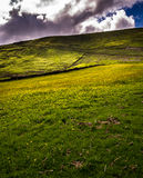 Meadows on side of the hill, Pendle Hill Royalty Free Stock Image