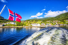 Meadows and village on Hardanger Fiord. Stock Photography