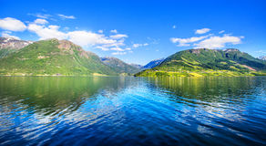 Meadows and village on Hardanger Fiord. Stock Photo
