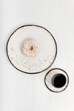 Meager colorful breakfast with a doughnut. Quick snack for quick start. Simple light morning meal consisting of a sweet doughnut and a cup of coffee being served Stock Images
