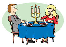 Meal. Man and a woman dinner by candlelight Royalty Free Stock Images