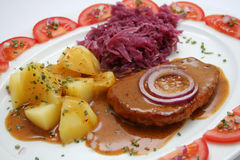 Meal. A meal of meat, potatoes and red cabbage Royalty Free Stock Photos