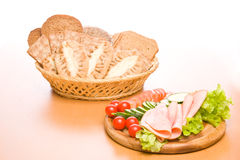 Meal. Fresh ham & salad on a wooden plate Royalty Free Stock Photo