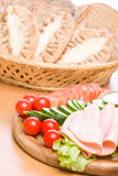 Meal. Fresh ham & salad on a wooden plate Royalty Free Stock Photography
