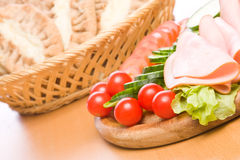 Meal. Fresh ham & salad on a wooden plate Royalty Free Stock Photos