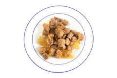 Meal for cats or dogs, industrial canned wet food on a plate  is Royalty Free Stock Images