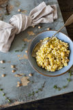 Meal of cereals with barley and chickpeas on bowl on rustic table with thyme sprigs Stock Photography