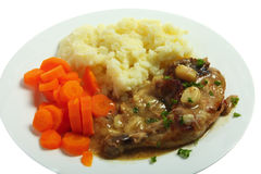 Meal of chicken in garlic with potato and carrot Stock Image