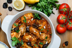 Meal of chicken tagine stew in a spicy, nutty tomato sauce and prunes Stock Images