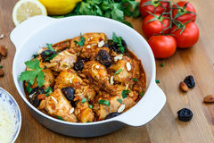 Meal of chicken tagine stew in a spicy, nutty tomato sauce and prunes Stock Photography