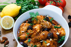 Meal of chicken tagine stew in a spicy, nutty tomato sauce and prunes Stock Photos
