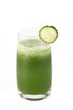 Meal  from a chlorophyll. Glass of cucumber juice and slice of a cucumber on a white background Royalty Free Stock Photo