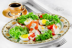Meal, coffee cup and newspaper on table Royalty Free Stock Images