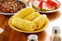 Meal with corn on the cob on a plate Stock Images