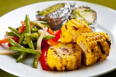 Meal of corn on the grill Stock Photos
