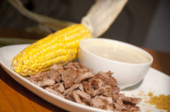 Meal with corn and roasted meat Stock Image