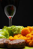 Meal with glass of wine closeup Stock Images