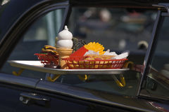 Meal on the Go. Tray of fast food hung on a car window Royalty Free Stock Photography
