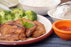 Grilled pork, broccoli, steamed rice and potato Royalty Free Stock Image