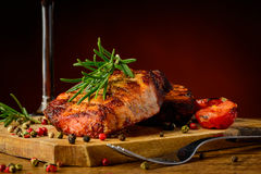Meal with grilled steak. Still life with grilled steak meal, herbs and spices Royalty Free Stock Photos