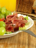 Meal with ham and salami Royalty Free Stock Image