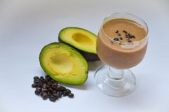 Meal. Healthy drink fueling the flesh for a healthy living life. Add more texture of Avocado, tasteful of coffee Royalty Free Stock Photo