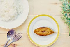 Healthy Lunch Ideas on wooden background,Spanish mackerel fried, Top View royalty free stock photo