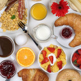 Meal with milk, fruits, coffee and orange juice from above Royalty Free Stock Images