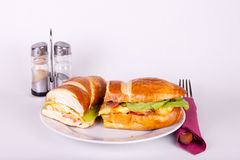 Meal for one. Delicius sandwich on plate with set for dining Stock Photography