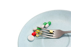 A meal of pills Royalty Free Stock Photography