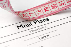 Meal plans. Close up of measure tape on meal plans Stock Photos